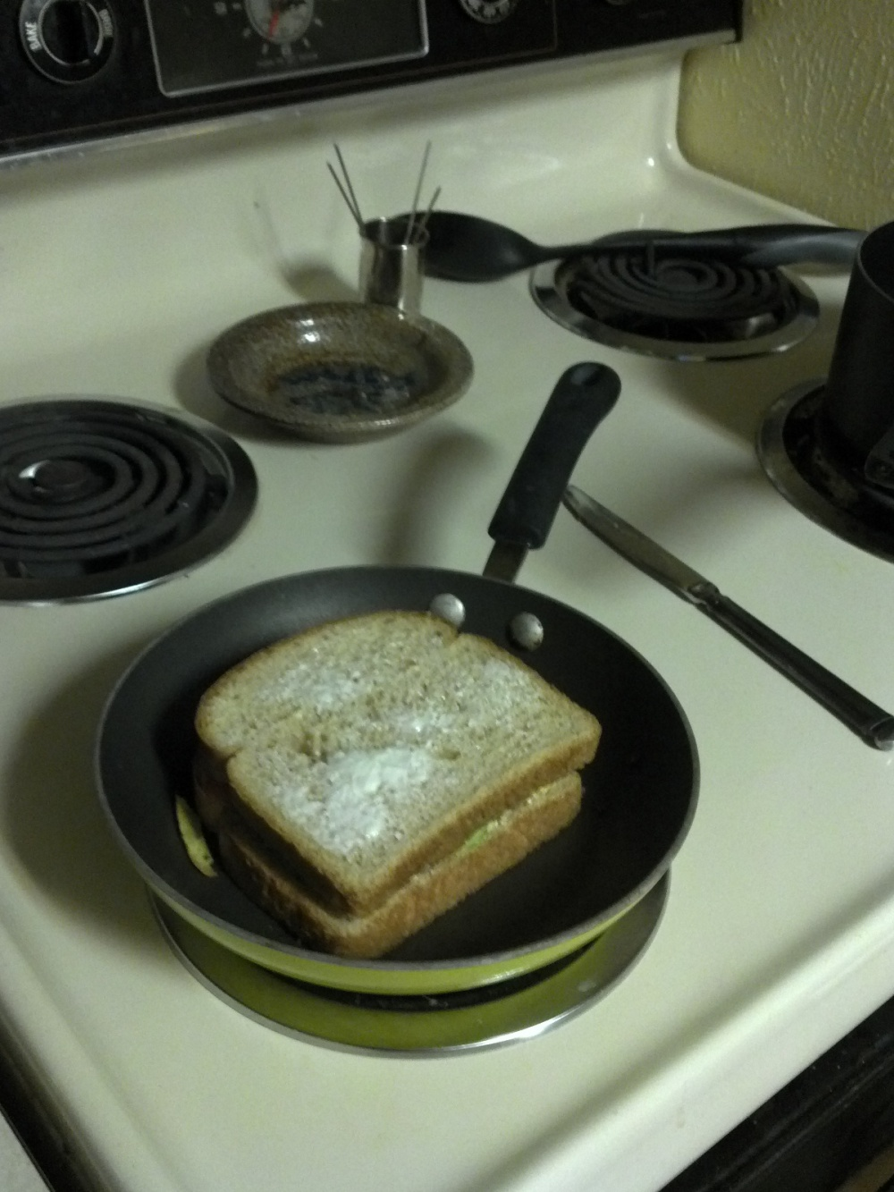 5 pm. Once again I'm cooking; this time grilled cheese with avocado and tomato.