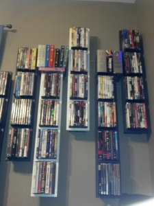 4:30 pm - Staring at the dvds on the wall, while laying on the couch, waiting for everyone to get there.