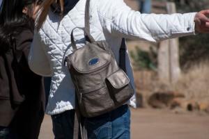 Metallic mini-backpack.