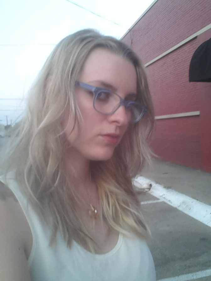 Test driving blue glasses in Deep Ellum.