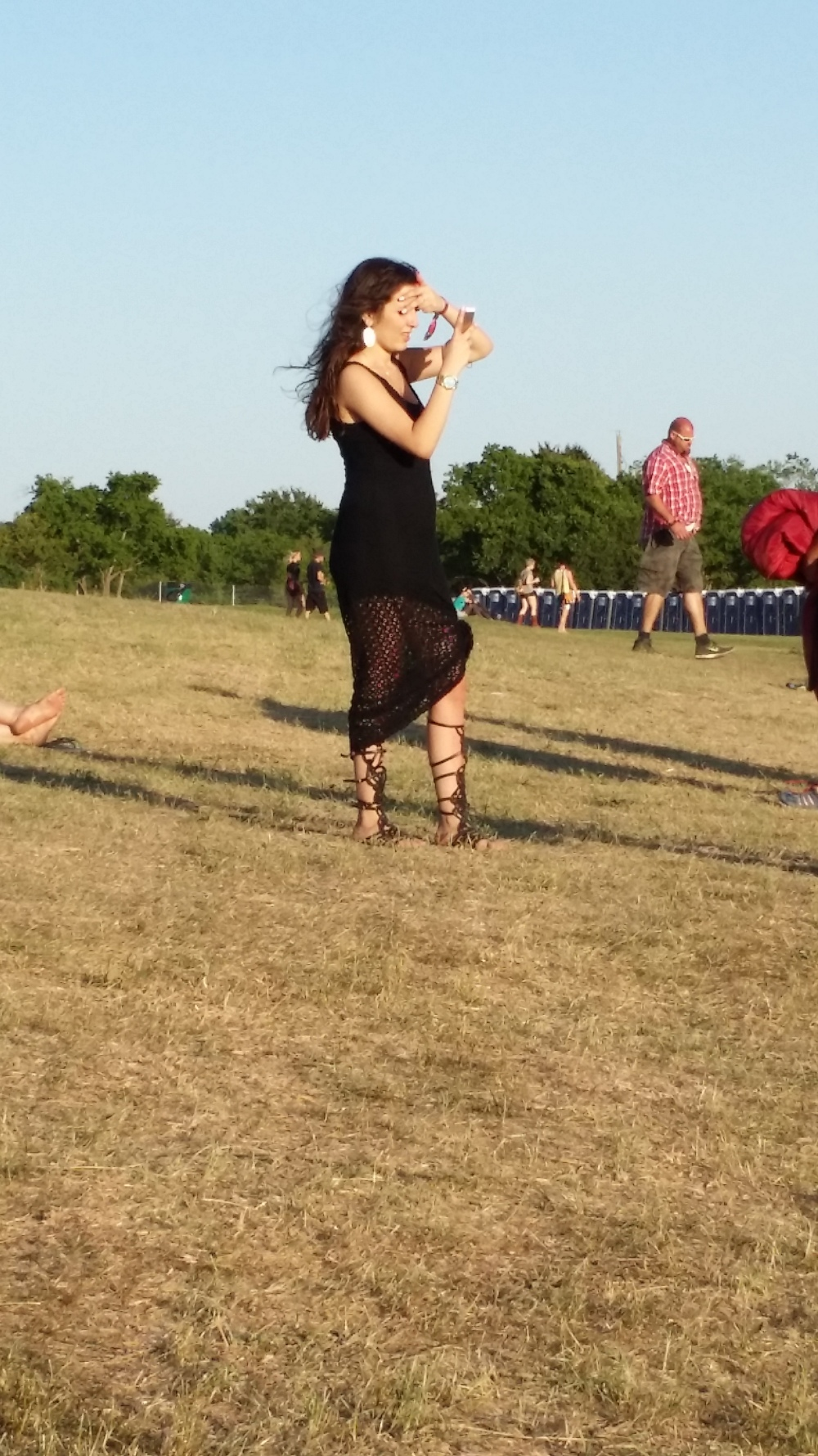 Black mesh dress, taking an outfit shot of her friend.