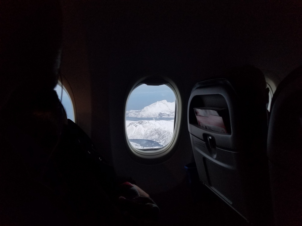 Flying from Oslo to Tromso, Norway - the moment the white sky opened on white mountains. November, 2016