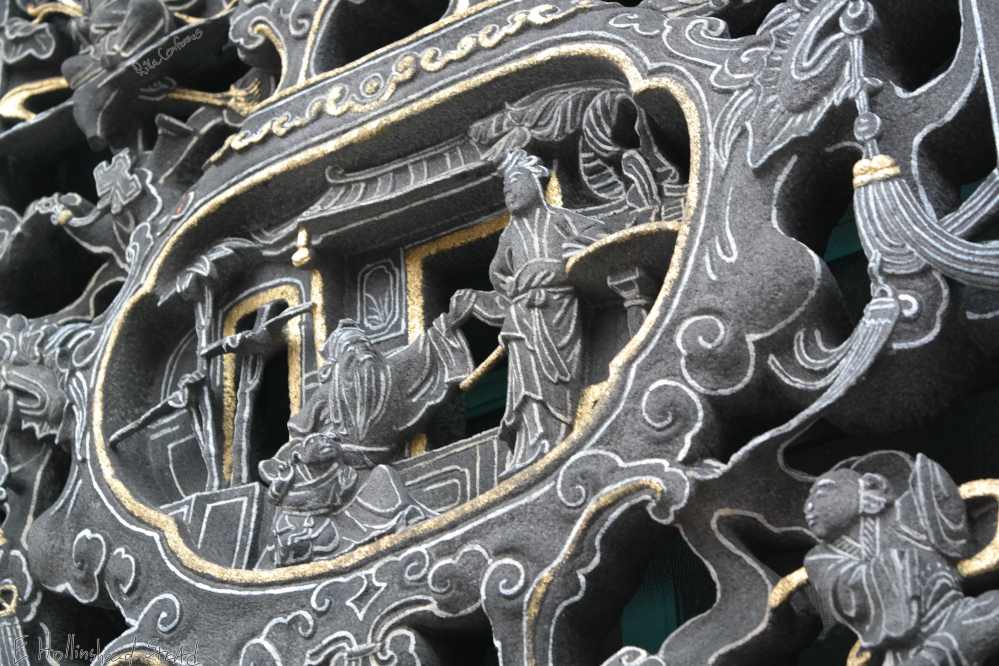close up detail from carved scene in Longshan Temple